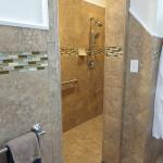 We love the gorgeous tile.  Plus, we're ADA compliant so it's easy getting in and out for showers with handrails in our specially designed showers in each of the private bath areas.
